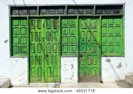 Old damaged wooden doors