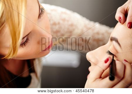 Makeup Artist Applying Makeup
