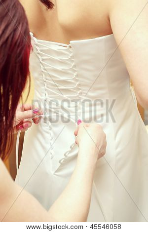 Helping With Bride's Corset, Wedding White Dress
