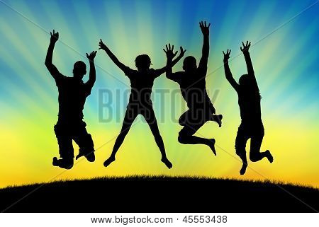Happy People Jumping In Joy On A Sunset Background