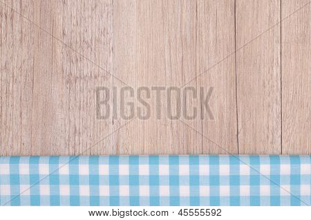 Light Blue Checkered Cloth On Wood