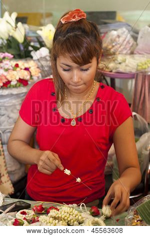 Bangkok, Thailand : Oct 12Th: Girl Making Buddhist Garlands On Bangkok's Flower Market On October 12