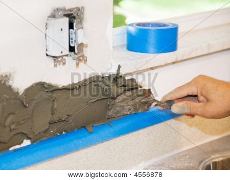 Tiler Applies Mortar