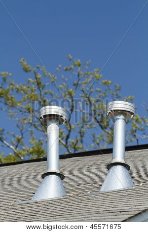 Two Residential Roof Exhaust Vents