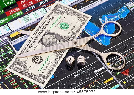 Scissors Cutting  One-dollar Banknote, Dices Cubes With The Word Sell Buy. Financial Charts And Colu