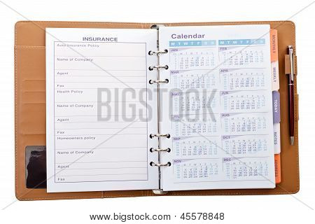Calendar In Notebook With Pen