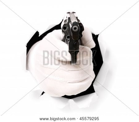 Man With Gloves Is Holding Gun In His Finger Through A Hole