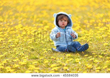 boy in spring flowers field