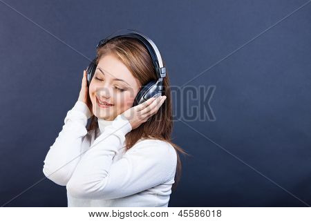 Smiling Woman Listening To Music In Headphones