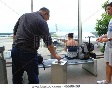 Stubbing Out Cigarette At Airport