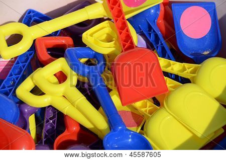 A display of colourful children's spades