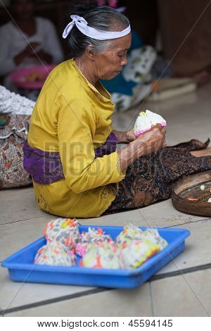 Balinese Woman Makes Sweets For Offerings