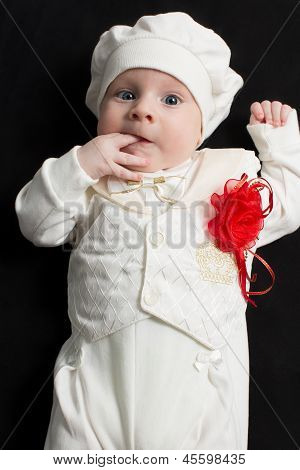 Adorable Baby Boy On Black Background. Babies And Children