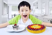 Boy Laughing With Desserts At Home