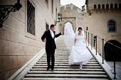 stock photo of castle  - Bride and groom wedding portraits in castle - JPG