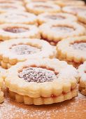 picture of linzer  - Closeup of Traditional Linzer Cookies on Wooden Board