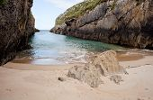 stock photo of cave woman  - Beach of Nueva de Llanes Asturias Spain - JPG