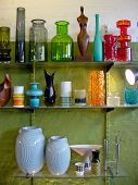 stock photo of thrift store  - Colorful miscellany of variously shaped vintage vases in glass and ceramics on display in an antiques store - JPG