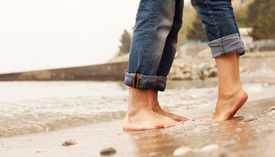 picture of barefoot  - Closeup image barefoot couple legs at the beach - JPG