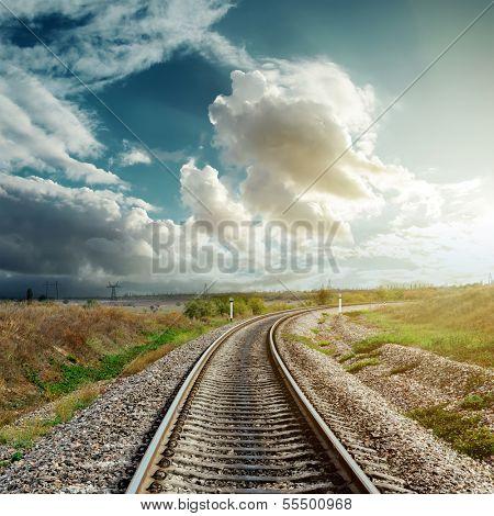 railroad goes to cloudy horizon