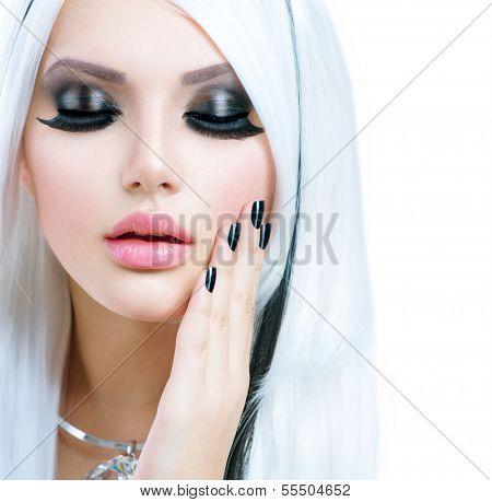Beauty Fashion Girl black and white style. Long White Hair with Black Stripes. Smoky Eyes Makeup and Black short Nails. Sexy Woman Portrait. False Eyelashes