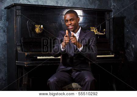 Black man near the piano
