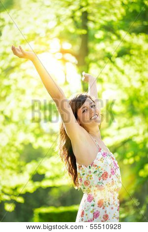 Successful Woman On Sunny Spring Park