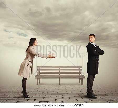 beautiful woman apologizing to man at outdoor