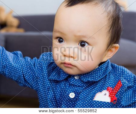 Asian baby boy staring at something