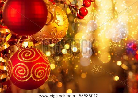Christmas and New Year Decoration. Bauble hanging on Christmas Tree. Holiday Glowing Background. Shallow DOF
