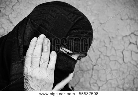 Arabic Muslim woman on cracked wall
