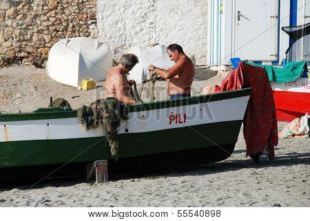 Fishermen on beach, Nerja, Spain.