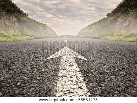 arrow on asphalt road to the horizon
