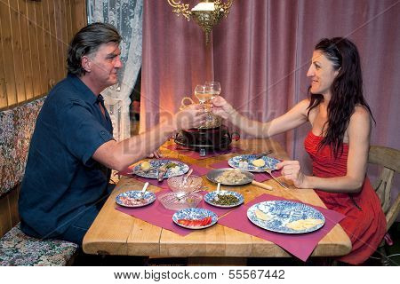 Couple Having Romantic Raclette Dinner.