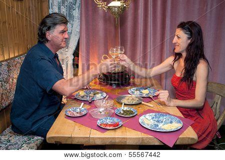 Couple Having Romantic Raclette Dinner.
