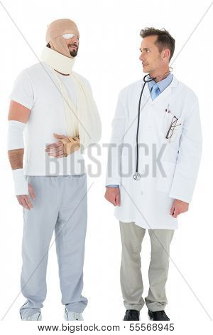 Doctor looking at a patient tied up in bandage over  white background