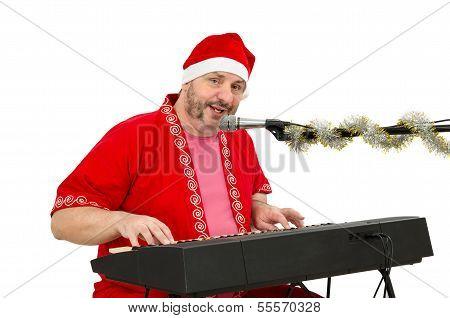 Man Wearing Santa Suit Plays And Sings