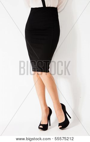 woman in elegant tight black skirt and high heel shoes