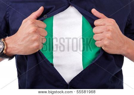 Young Sport Fan Opening His Shirt And Showing The Flag His Country Nigeria, Nigerian Flag