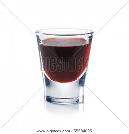 Red berries liqueur is the shot glass isolated on white. Bar and restaurant concept.