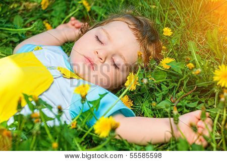 Sleeping boy on grass