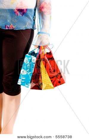 Image Of Female Holding Shoppingbags In Her Hand Isolated On White
