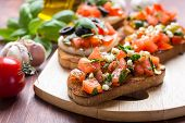 stock photo of tomato sandwich  - Italian Appetizer Bruschetta with roasted tomatoes - JPG