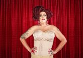 picture of drag-queen  - Drag queen in corset with hands on hips - JPG
