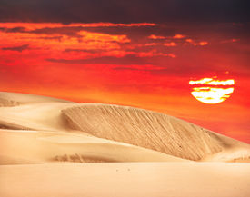 image of barchan  - Desert with orange sky and big sun in Kazakhstan Central Asia - JPG