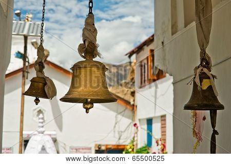Bronze Bells In Front Of Buddhist Temple. India