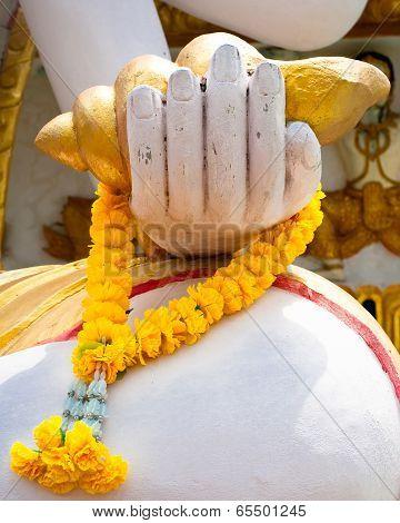 Buddhas Hand With Flower Garland. Thailand