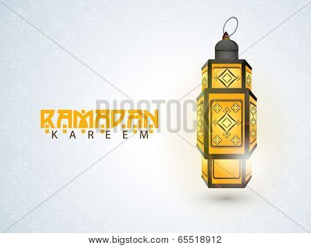 Illuminated arabic lantern on blue background for holy month of muslim community Ramadan Kareem.