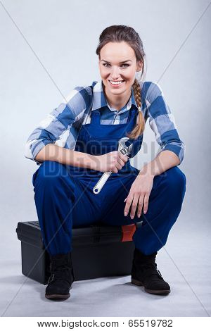 Woman Sitting On Toolbox