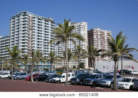 Parked Vehicles And Palm Trees Against Residential Complexes